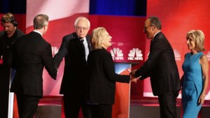 Democratic presidential candidate, Hillary Clinton greets NBC moderator Lester Hold at the end of the NBC, YouTube Democratic presidential debate at the Gaillard Center, Sunday, Jan. 17, 2016, in Charleston, S.C. To the left Democratic presidential candidates, former Maryland Gov. Martin O'Malley and Sen. Bernie Sanders, I-Vt. shake hands. To the right is NBC moderator Andrea Mitchell. (AP Photo/Stephen B. Morton)