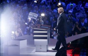 Republican U.S. presidential candidate Donald Trump appears onstage to introduce his wife Melania at the Republican National Convention in Cleveland, Ohio, U.S., July 18, 2016. REUTERS/Carlo Allegri