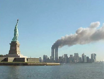 This image has an empty alt attribute; its file name is National_Park_Service_9-11_Statue_of_Liberty_and_WTC_fire.jpg